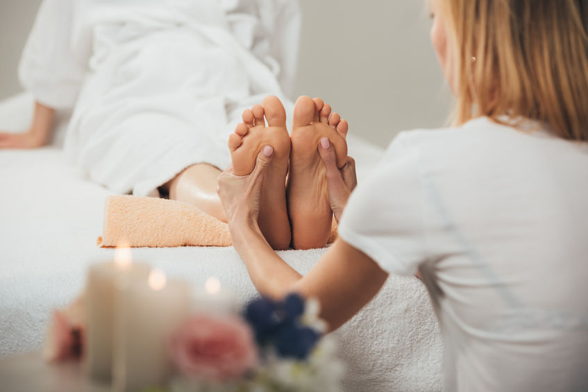 foot massage by a blonde lady in a spa