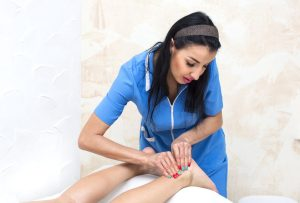 Neuromuscular Massage Therapy done on a woman's back legs