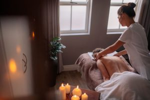Woman receiving body massage at spa center